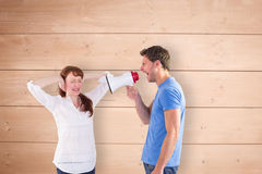 Composite image of man shouting through a megaphone Royalty Free Stock Photos