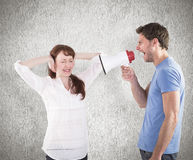 Composite image of man shouting through a megaphone Stock Photo