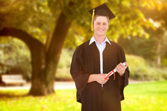 Composite image of man smiling as he has just graduated with his degree Stock Images