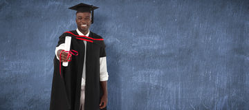 Composite image of man smilling at graduation Royalty Free Stock Photos