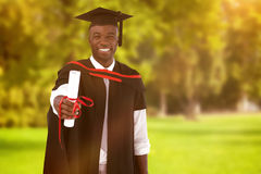 Composite image of man smilling at graduation Stock Image
