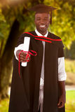 Composite image of man smilling at graduation Royalty Free Stock Images