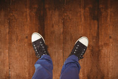 Composite image of man standing on hardwood floor Royalty Free Stock Image