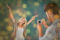 Composite image of man taking photo of his pretty girlfriend Stock Photo