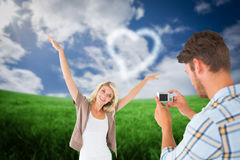 Composite image of man taking photo of his pretty girlfriend Royalty Free Stock Image