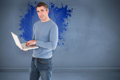 Composite image of man using a laptop Stock Image