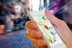 Composite image of man using map app on phone Stock Photography
