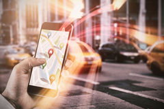 Composite image of man using map app on phone. Man using map app on phone against blurry new york street Royalty Free Stock Images