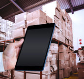 Composite image of man using tablet pc Royalty Free Stock Image