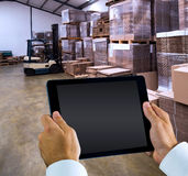 Composite image of man using tablet pc Stock Photography