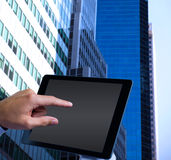 Composite image of man using tablet pc Stock Photo
