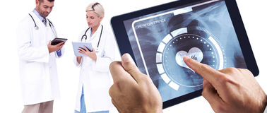 Composite image of man using tablet pc Stock Image