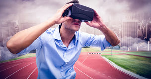 Composite image of man using a virtual reality device Stock Photos