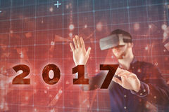 Composite image of man using virtual reality simulator Royalty Free Stock Photography