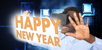 Composite image of man with virtual reality headset while gesturing against white background Royalty Free Stock Images