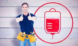 Composite image of man wearing tool belt while showing thumbs up sign Royalty Free Stock Images