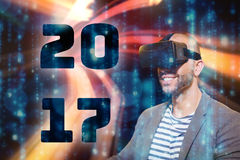 Composite image of man wearing virtual simulator headset Stock Photos