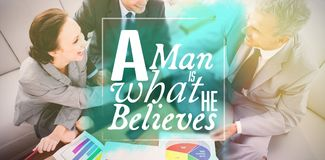 Composite image of a man is what he believes. A men is what he believes against business people shaking hands while working Stock Images