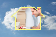 Composite image of man writing withmarker on moving box Stock Photography