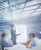 Composite image of manager presenting whiteboard to his colleagues Stock Image