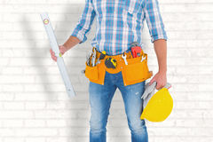 Composite image of manual worker holding spirit level Royalty Free Stock Photography