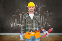 Composite image of manual worker holding various tools Stock Image