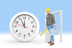 Composite image of manual worker with spirit level and toolbox Royalty Free Stock Photography