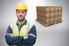 Composite image of manual worker wearing hardhat and eyewear Royalty Free Stock Image