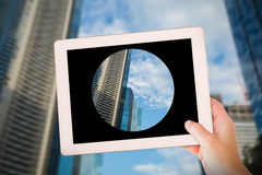 Composite image of masculine hand holding tablet Royalty Free Stock Images