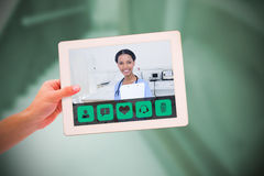 Composite image of masculine hand holding tablet. Masculine hand holding tablet against empty bed in the hospital room Stock Photography