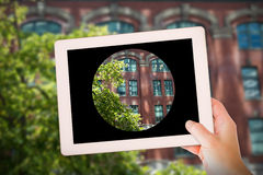 Composite image of masculine hand holding tablet Stock Photos