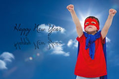 Composite image of masked boy pretending to be superhero. Masked boy pretending to be superhero against sky with sun Stock Photography