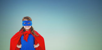 Composite image of masked girl pretending to be superhero Stock Photos
