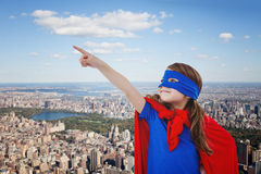 Composite image of masked girl pretending to be superhero Stock Images
