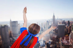 Composite image of masked girl pretending to be superhero Stock Photography