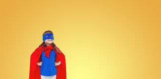 Composite image of masked girl pretending to be superhero Royalty Free Stock Image