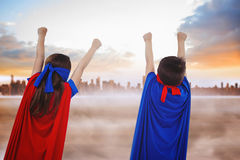 Composite image of masked kids pretending to be superheroes Royalty Free Stock Photography