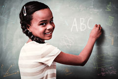 Composite image of math and science doodles. Math and science doodles against cute little girl writing abc on blackboard Royalty Free Stock Photo
