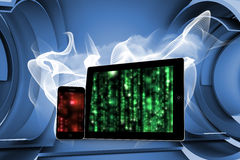 Composite image of matrix on tablet and smartphone screens stock illustration