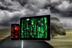 Composite image of matrix on tablet and smartphone screens Royalty Free Stock Photography