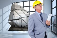 Composite image of mature architect taking a close look Royalty Free Stock Photography
