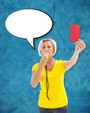 Composite image of mature blonde showing red card to camera. Mature blonde showing red card to camera against blue Royalty Free Stock Photography