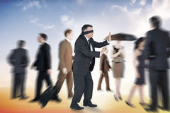 Composite image of mature businessman in a blindfold Stock Photos