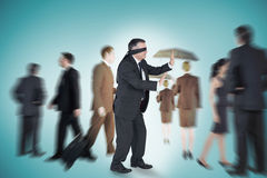 Composite image of mature businessman in a blindfold Royalty Free Stock Image