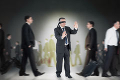 Composite image of mature businessman in a blindfold Royalty Free Stock Photo
