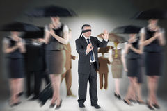 Composite image of mature businessman in a blindfold Stock Images