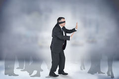 Composite image of mature businessman in a blindfold Stock Photography