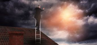 Composite image of mature businessman climbing career ladder Royalty Free Stock Images