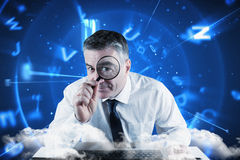 Composite image of mature businessman examining with magnifying glass Royalty Free Stock Photography