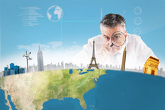 Composite image of mature businessman examining with magnifying glass Stock Photo